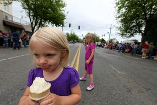 In the middle of the parade route, eating ice cream